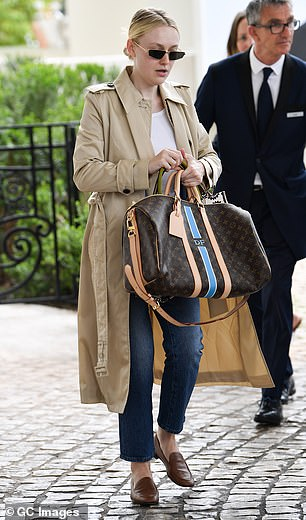 Chic: The actress appeared to be heading home, as she carried her personal items in a large Louis Vuitton suitcase and a Christian Dior handbag