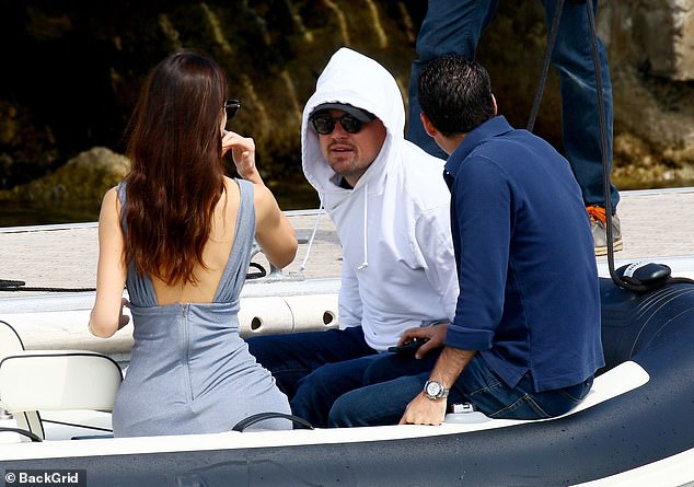 Smitten: Leo gazed at his beautiful girlfriend as they set sail at Cannes