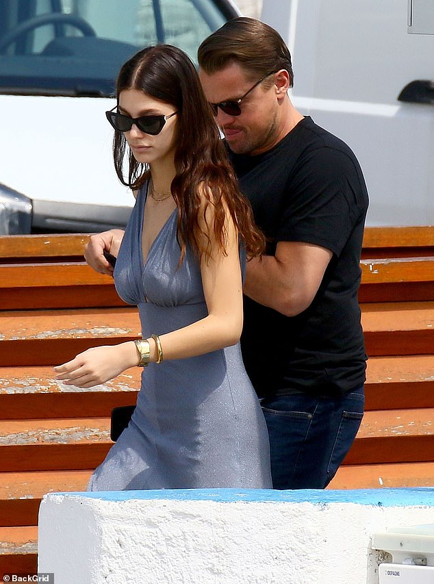 Romance:Leonardo DiCaprio and girlfriend Camila Morrone looked smitten as they boarded a yacht during a break in the actor's busy schedule at the Cannes Film Festival on Thursday