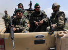 Afghan National Army soldiers kept watch at the gate of the Afghan air force compound in Kabul on Wednesday after an officer attacked NATO troops.