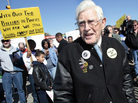 """Olen Ham wears a """"Hands off my Pension"""" button as he joins workers and their supporters to protest against two-tier wages outside the United Auto Workers union Solidarity house in Detroit, last October."""