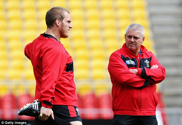 Highly rated: Wales head coach Warren Gatland (right) believes Jenkins is a key player for the World Cup