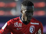 Lille's Senegalese midfielder Idrissa Gueye (R) vies for the ball with Evian's Ivoirian midfielder Djakaridja Kone during the French L1 football match between Evian (ETGFC) and Lille (LOSC) on April 12, 2015 at the Parc des Sports in Annecy, southern France. AFP PHOTO / JEAN-PIERRE CLATOT        (Photo credit should read JEAN-PIERRE CLATOT/AFP/Getty Images)