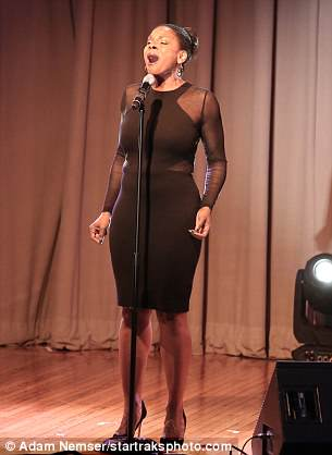 She wore a black sheer dress that made the most of her curves