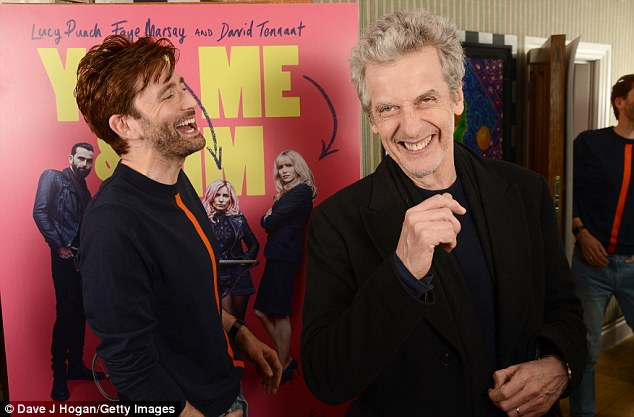 Having fun: David looked relaxed as he spent time with his successor, whose grey locks were brushed back for his trademark look, and the pair were spotted in a fit of laughter at the event