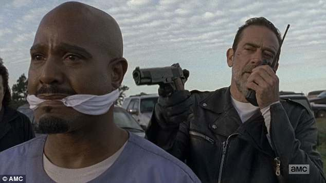 Death imminent: Negan also had a gun pointed at the back of Father Gabriel's head