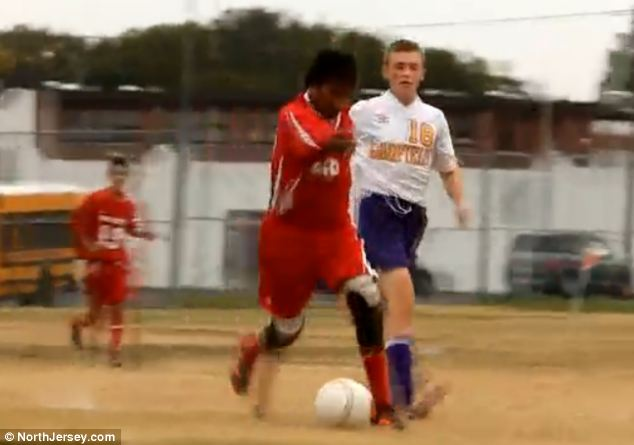 Inspirational: Sixteen-year-old Jorge Dyksen, whose four limbs were amputated when he was 14-months-old, scored a goal for his New Jersey soccer team in a match on Friday