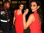Eyes on the prize: Kim Kardashian stuns in red at the Marine Corps Ball, leaving her date struggling not to stare