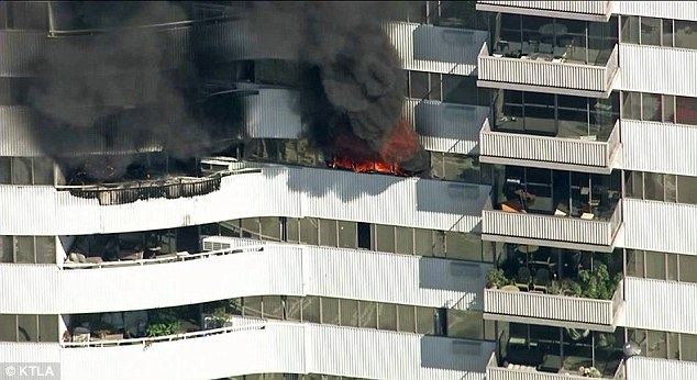 Midday blaze: The fire on the 11th floor of the 25-story Barrington Plaza building, which is located at 11740 Wilshire Boulevard, was reported at 11:43 a.m., officials said
