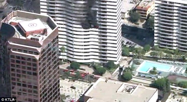 Inferno: It took the Los Angeles Fire Department almost two hours to put out a fire on the 11th floor of a 25-story building in Brentwood. 214 firefighters battled the blaze