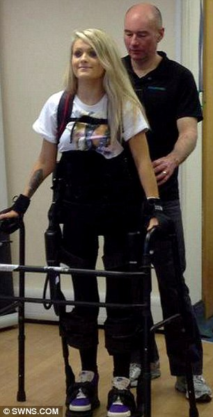 Walking: Jordan stands up with her bionic legs for the first time since a car crash left her paralysed