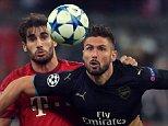 Bayern Munich's Javi Martinez (left) and Arsenal's Olivier Giroud battle for the ball