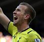 Tottenham Hotspur's Harry Kane celebrates his goal during their English Premier League soccer match between Newcastle United and Tottenham Hotspur at St James' Park, Newcastle, England, Sunday, April, 19, 2015. (AP Photo/Scott Heppell)