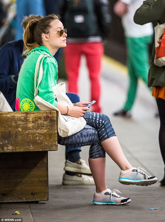 Watch your step: Olivia Wilde, 31, sat waiting to board the subway to Brooklyn on Wednesday