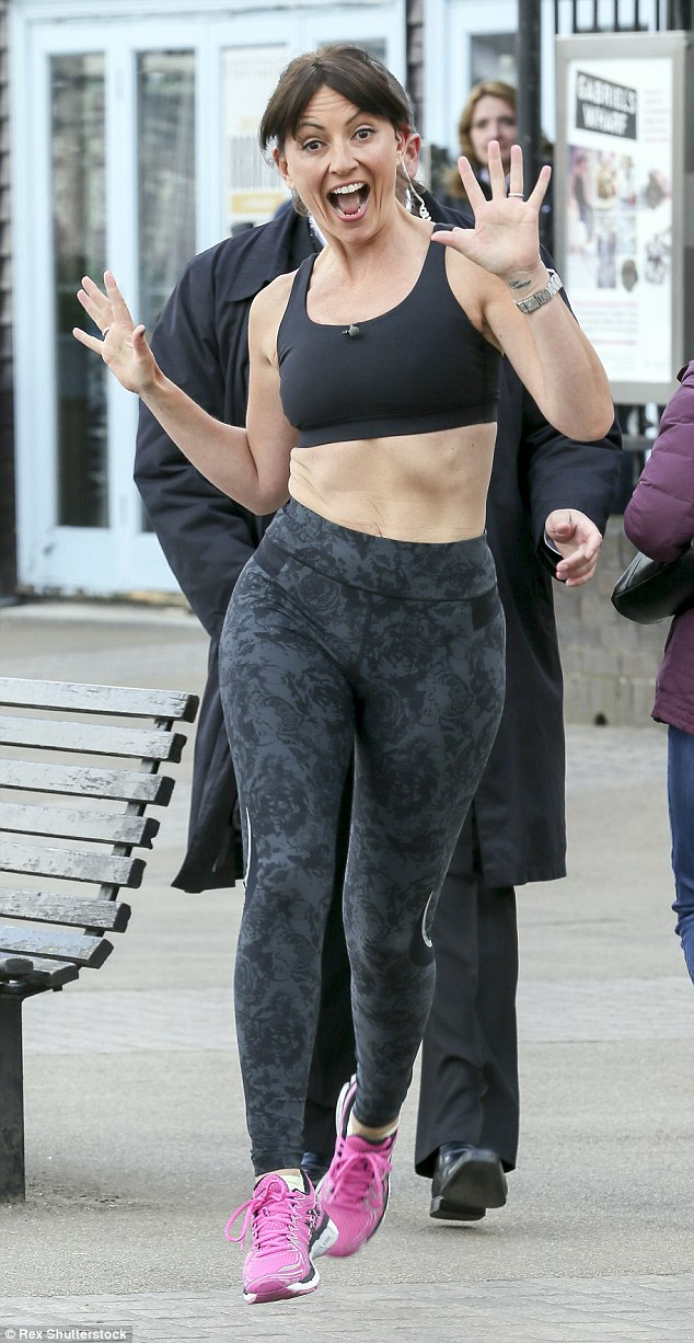 Full of beans: Davina McCall was her usual bubbly self as she arrived at the ITV studios in central London on Monday morning ahead of her appearance on This Morning