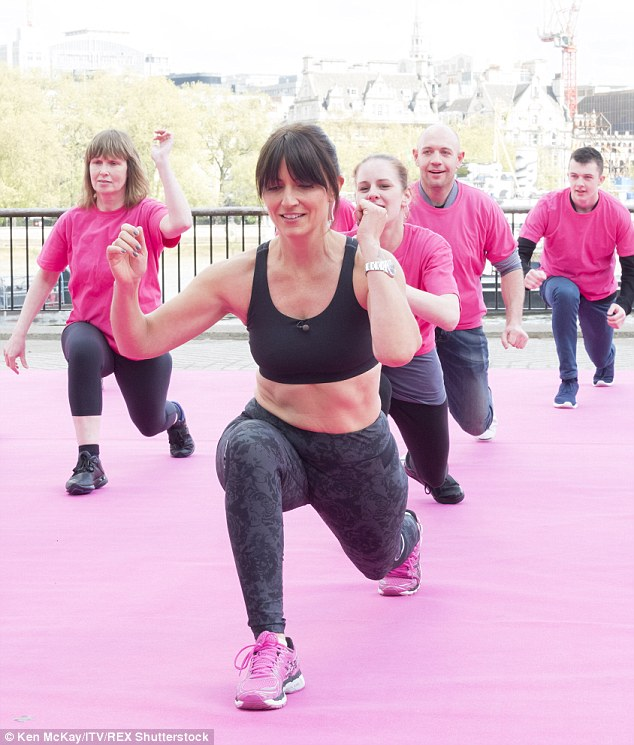 Working up a sweat: The 47-year-old star got straight to work, enlisting a crowd of strangers to help her perform her 7 Minute Fit routine
