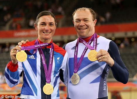 Golden couple: Sarah with her husband Barney Storey posing with the medals they won in the Velodrome at the Paralympics
