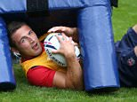 BAGSHOT, ENGLAND - SEPTEMBER 14:  Sam Burgess ends up underneath a tackle bag during the England training session at Pennyhill Park on September 14, 2015 in Bagshot, England.  (Photo by David Rogers/Getty Images)