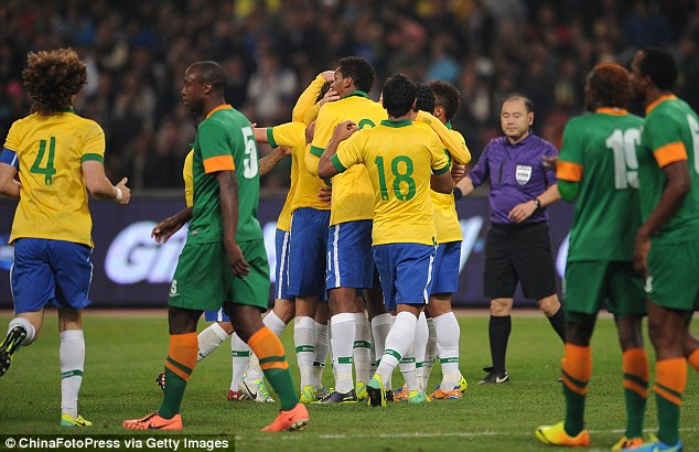 Mobbed: Oscar was then swamped his his Brazilian comrades