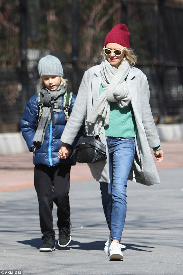 Double take: Naomi was seen wearing an almost identical outfit days earlier while out picking her son up from school
