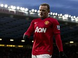 Don't go: Manchester United favourite Andy Cole has warned Wayne Rooney not to leave the club this summer