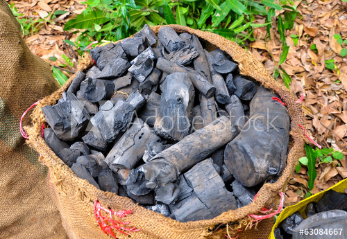 close up wooden charcoal in sacks