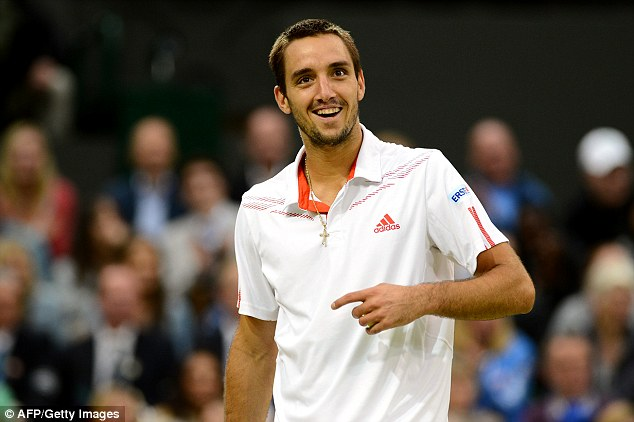 Are you talking to me? Serbia's Viktor Troicki reacts with disbelief after getting unsolicited advice from a fan