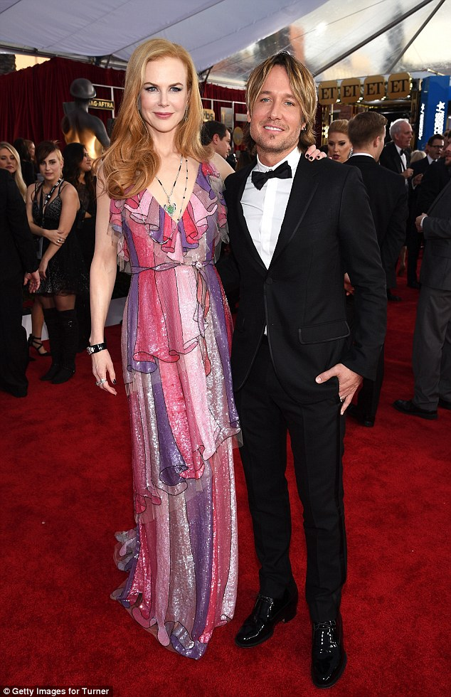 United: The actress, pictured with country singer husband Keith Urban at the Screen Actors Guild Awards  in Los Angeles in January, say their two daughters are 'a joy'