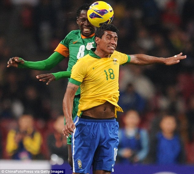 Heads up: Spurs' Paulinho competes in the air