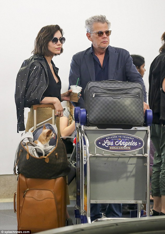 Newly-engaged:Katharine and David were seen touching down in Los Angeles on Saturday