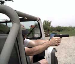 """""""Shooting while seated in a vehicle is a skill that must be developed through repeated practice."""" (Wayne Becker photo.)"""