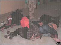 A group of bound Iraqi prisoners at the Abu Ghraib prison near Baghdad, Iraq in this undated photo. (AP Photo/Courtesy of The New Yorker)