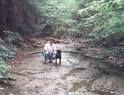 Karl and Sadie hiking through Shale Creek, 8/97