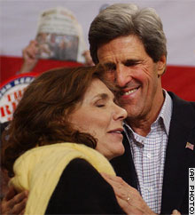 John Kerry embraces his wife, Teresa, as they meet with supporters Tuesday in Manchester, New Hampshire.