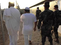 Two detainees are escorted to a medium security facility at Guantanamo Bay, Cuba.
