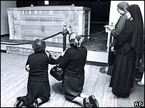 Two women and two nuns at the tomb of the previous pope, John Paul I, in 1978.