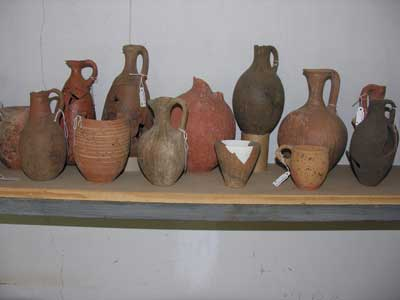 EBIV pots on display on a shelf in the dighouse.