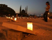Peace activists set up 400 candle-lit mock tombstones in Beirut's central district, August 8, 2006. REUTERS/Jamal Saidi