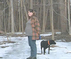 A very pregnant Jen Weir walking with Sadie in Walton Woods