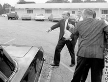 Lester Maddox brandishes a pistol during an unsuccessful attempt by three black men to desegregate his restaurant in Atlanta, Georgia, the day after the Civil Rights Act was signed into law in 1964.