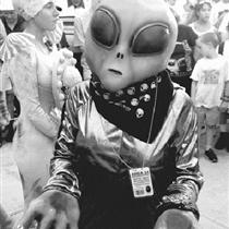Not a real alien, Crystal Graham is shown wearing an extraterrestrial costume in a 1997 contest at Roswell, New Mexico, where a UFO allegedly crashed in 1947.