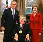 2004 National Medal of Arts award recipient Ray Bradbury with President George W. Bush and his wife Laura Bush.