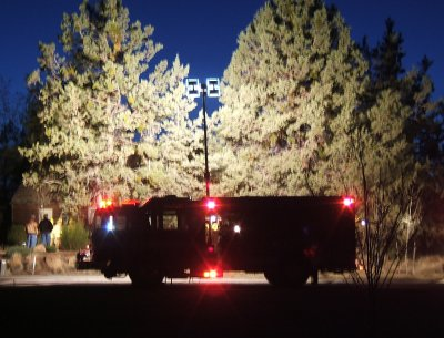 Fire truck lighting up the scene at night