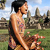 Cambodian woman carries water lilies at Angkor Wat temple