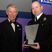 The Prince of Wales presents an award to Greater Manchester Pc Geoffrey Hince