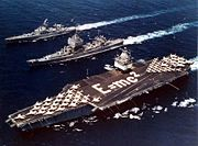 USS Enterprise, Long Beach and Bainbridge in formation in the Mediterranean, 18 June 1964. Enterprise crewmembers spelled out the mass–energy equivalence formula on the flight deck to commemorate the first all-nuclear battle formation.