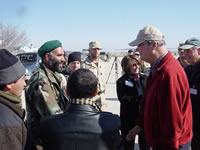 Image of Congressman with Soldiers