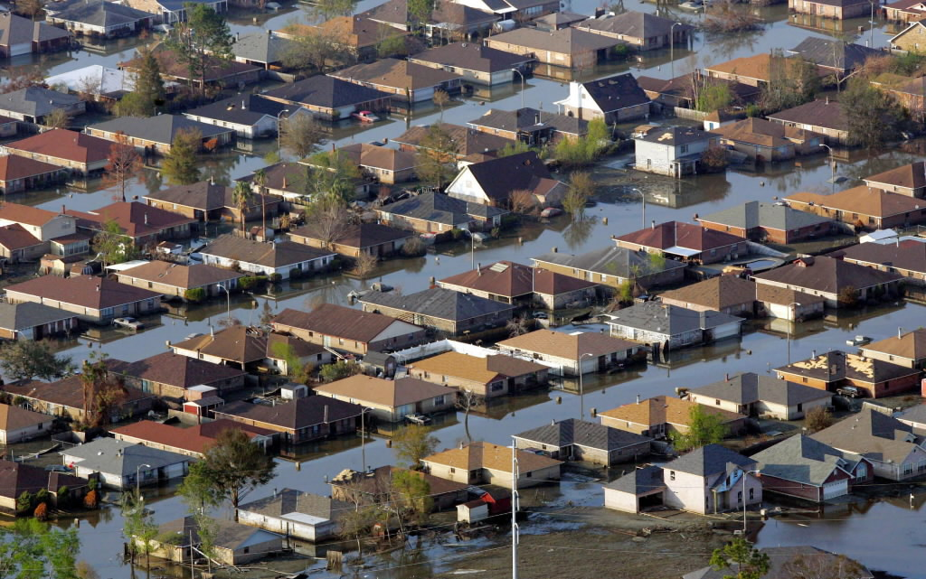 Neighborhoods are flooded with oil and water two weeks after Hurricane Katrina went though New Orleans in this Sept. 12, 2005 file photo.