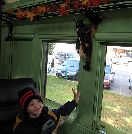 witches and leaves decorate the Halloween Train