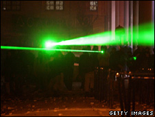 Protesters in Athens shine lasers at riot police to distract and target them (13 December 2008)